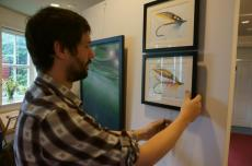 Angus hanging Beyond Reasonable Trout exhibition