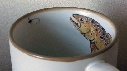 Chasing the fly mug, Angus Grant Art