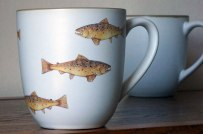 A hover of trout mug, by Angus Grant Art