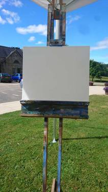 Angus Grant painting outdoors, blank canvas