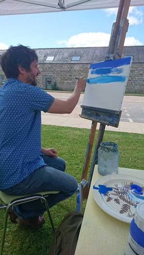 Angus Grant painting outdoors