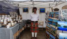 Angus Grant Art craft fair stall kilted