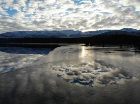 Loch Morlich and the Cairngorms photo by Angus Grant