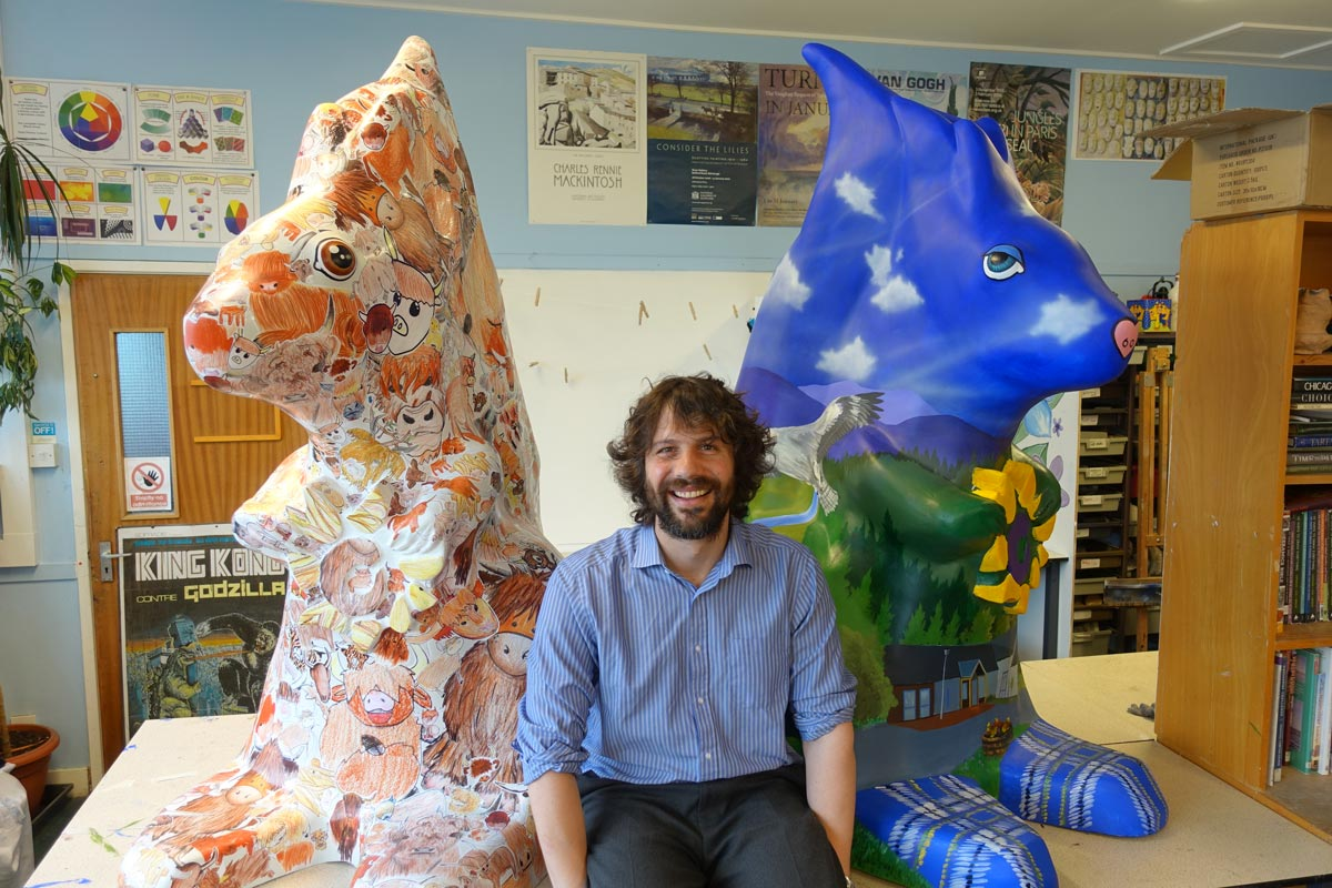 Angus Grant with the two finished squirrels for the Highland Hospice