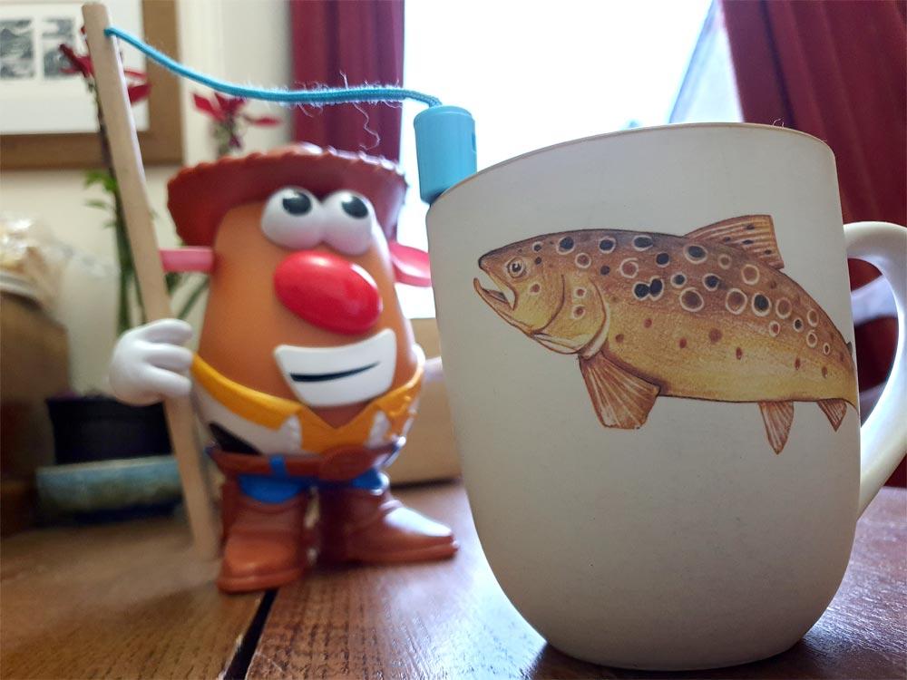 Mr Potato Head fishes for an Angus Grant Art mug